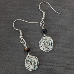 Silver wire rose earrings with black rainbow bead | aluminum wire woven rose beaded dangle earrings - JustArtisan - Scribbles & Knots -