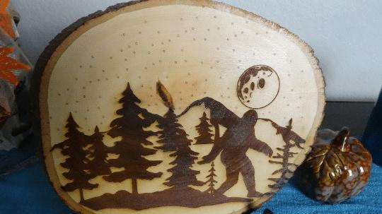 Rustic Big Foot walking through the forest at night. laser cut on a Bass wood wood slice 10.5 x 8.5 - JustArtisan - Poppy Place -