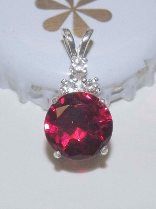 Rich ruby pendant in silver with three accent sapphires. - JustArtisan - Mat's Machinations -